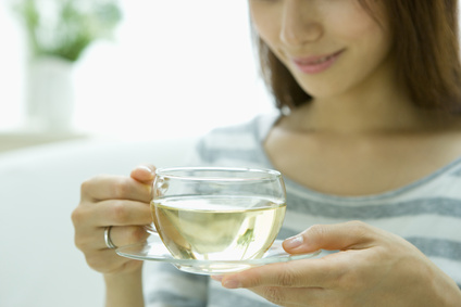 Woman drinking herb tea